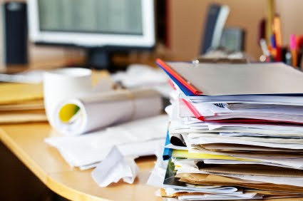 papers and files stacked on desk