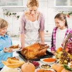 mother preparing food with children